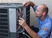 Simpson Air HVAC tech repairing AC unit at a Tampa home